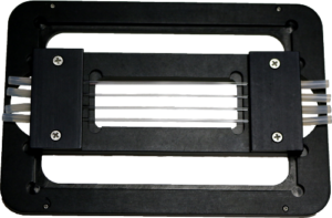 Black anodized aluminum capillary flow cell and glass capillaries